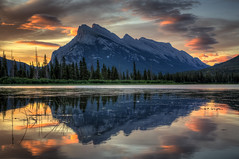 Present in all its glory (JoLoLog) Tags: trees lake canada mountains sunrise joe alberta rockymountains mountrundle refelctions banffnationalpark canadianrockies vermilionlakes canonxsi