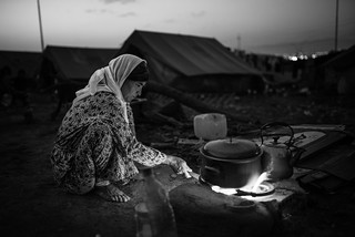 A Yazidi mother preparing the dinner in the refugees camp of Zakho (Iraq)