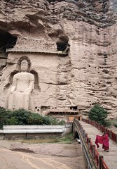 Great Maitreya Buddha Bingling Thousand Buddha Caves Lanzhou Gansu Province China (eriagn) Tags: unescoworldheritagesite bingling thousandbuddha caves relief carving buddha buddhism religion ancient historical archaeological worship landscape monk red bridge rock cliff geology seatedbuddha tourist tourism pilgrims pilgramage yellowriver langzhou gansuprovince china asia ngairelawson ngairehart eriagn travel silkroad threadsinthesand robes overcast rain silt sculpture rocksculpture rockcutarchitecture sandstone littlestoriespicswithsoul earthslandscapes