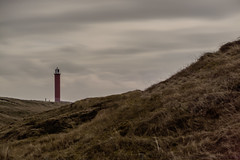 Lighthouse in dunes (lg-photographic) Tags: weather wetter long exposure langzeitbelichtung outdoor drausen dunes dünen lighthouse leuchtturm building gebäude sky himmel dark dunkel grass gras landscape landschaft north sea nordsee nature natur julianadorp netherlands niederlande nikon d5200