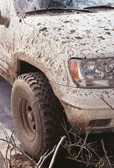 (Lesley Rivera) Tags: white film car 35mm canon photography rebel fuji mud baltimore dirty dirt headlight