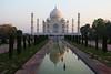 The Taj Mahal and reflective pool at dawn (Heaven`s Gate (John)) Tags: world trees sunlight reflection art heritage pool architecture sunrise dawn site taj mahal agra icon unesco marble 10faves 25faves johndalkin heavensgatejohn