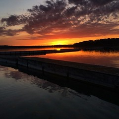 Bowers Harbor Dock Sunset (matthewkaz) Tags: sunset sky sun lake reflection water clouds square dock michigan lakemichigan greatlakes squareformat 2014 oldmissionpeninsula bowersharbor iphoneography instagramapp uploaded:by=instagram
