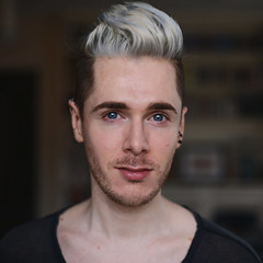 Blonde Ambition (Mark Liddell) Tags: blue boy portrait people white haircut man guy me smile self hair beard book scotland eyes industrial bokeh cut glasgow chest scottish style lips piercing shelf blond ear blonde scaffold ash freckles quiff hairstyle platinum eyebrows stubble moles toner cartilage clavicles markliddell