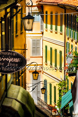 High Angle View of a Hilly Street with Colorful Buildings, Bellagio, Lake Como, Lombardy, Italy (George Oze) Tags: travel summer italy lake como vertical architecture outdoors colorful europe fineart perspective scenic nobody it historic shutters shops balconies daytime bellagio lookingdown charming quaint lakecomo hilly lampions awnings shopwindows redflowers lombardy northernitaly pastelcolors streetphotgraphy steepstreet highangleview lakesidevillage italyvarious buildingexteriors provinceofcomo shopfrontd
