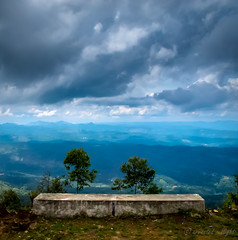 A seat for the view (Arrested Sunlight) Tags: india mist beautiful rain clouds garden drive tour scenic roadtrip kerala resort route plantation hillstation westernghats munnar teaestate tealeaves refresh nilgirirange