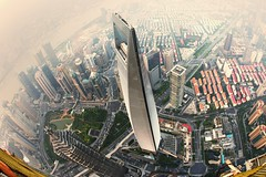 Taller than tall (Tony Shi Photos) Tags: china skyline modern skyscraper shanghai wideangle fisheye pointofview 中国 上海 pudong 城市 陆家嘴 development futuristic vantagepoint tallest birdeye 金茂 lujiazui swfc 上海市 大厦 shanghaitower highangleview shanghaiworldfinancialcenter 摩天楼 鱼眼 上海环球金融中心 金融区 上海中心
