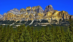 The Horizon Dominating Mount Castle (LostMyHeadache: Absolutely Free *) Tags: blue autumn trees sky mountain mountains green castle fall nature rock forest canon rockies gold nationalpark rockymountains peaks ridges canadianrockies davidsmith rockfaces calgaryalbertacanada lakelouisenationalpark mountcastle eos60d