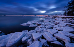 Ice Plates #02 (tinamar789) Tags: winter ice sea seashore seascape darkening blue hour horizon snow clouds cold frozen lauttasaari helsinki finland