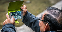 2016 - China - Yangtze River - Tribe of the Three Gorges - 12  of 23 (Ted's photos - Returns 23 Jun) Tags: 2016 china cropped nikon nikond750 nikonfx tedmcgrath tedsphotos tribeofthethreegorges vignetting yangtzeriver photographer cellphone samsung thumbs hands bokeh