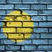 National Flag of Palau on a Brick Wall