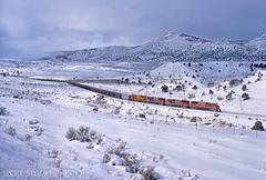 Soldier Summit (rolfstumpf) Tags: usa utah soldiersummit winter snow train railway railroad coaltrain locomotives utahrailway mk5000c mountains wasatch sd503 mamiya 645super fujichrome rdp