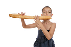 Baguette (Schnapps2012) Tags: portrait food white cute girl female french bread fun healthy holding funny pretty child eating background young happiness tasty fresh health baguette bakery meal attractive teenager products hungry brunette loaf cheerful product baked teenage nutrition caucasian appetite