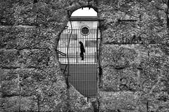 Berlin - East to West (luca marella) Tags: street urban bw white black wall germany blackwhite aperture hole documentary pb bn bianco nero reportage marellaluca