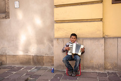 Boy on the Accordion_4367 (hkoons) Tags: street city music roma musicians europe exercise coins song stage country nation performance performing saints culture poland krakow polish streetscene accordion beggar sidewalk sing acting instrument onstage tune instruments krakw cracow panhandler act easterneurope rhythm beg panhandle chant musicianssaint