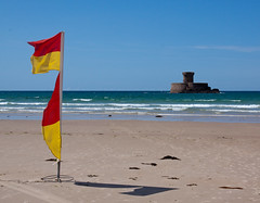 La Rocco Tower from St Quen's Bay, Jersey, Channel Islands (David May) Tags: tower beach flag safe bathing zone rnli