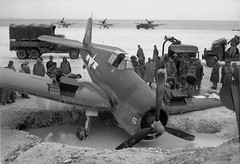 F6F-3 Hellcat of Navy Fighting Squadron 33 after dropping into a bomb crater at the Barakoma airstrip, Vella Lavella, Solomons Island, late 1943.