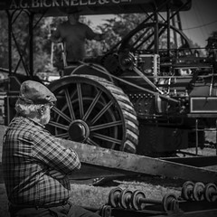 Just Watching (Dan Carter 1993) Tags: old blackandwhite tractor man contrast vintage square beard grey sony watching traction engine steam just grandad alpha dslr