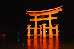 Miyajima Island Torii (Lark Ascending) Tags: sea reflection night gate shrine illuminated hiroshima shinto vermilion islanditsukushima iyajima isolandtoriitorii