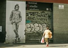 La vida pasa (Pankcho) Tags: barcelona street woman art lady walking photography graffiti calle shadows arte catalonia catalunya elraval groceries barrio sombras iec cataluña compras raval caminando plaça fotografía señora salvadorseguí