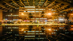 when puddle dazzled (jm morata) Tags: reflection puddle triangle philippines makati ayala