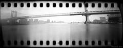 (david sine) Tags: city newyorkcity bridge sky blackandwhite bw newyork film water brooklyn 35mm river kodak tmax things pinhole 400 stuff manhattanbridge eastriver homemadecamera pencilholder itactuallyworked