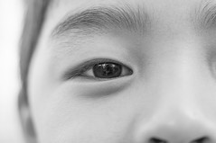 (nzfisher) Tags: boy macro eye smile face childhood closeup children 50mm child expression portraiture
