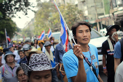 Krung Thep, the city of angels (fredcan) Tags: street travel man face thailand march asia southeastasia bangkok politics crowd flags demonstration thai yellows youngman protesters antigovernment krungthep thecityofangels fredcan yingluckshinawatraout