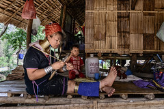 Padaung Lady and Child (Anoop Negi) Tags: padaung karen tribe tribal thailand burma mynamar chiangmai portrait mother child knife machete bamboo long neck people photo photography anoop negi ezee123 ethnography