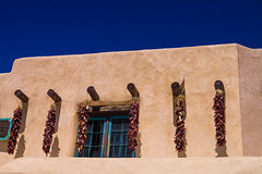 Red chile ristras in Santa Fe, New Mexico (julesnene) Tags: newmexico santafe building cooking architecture display decoration bluesky adobe string welcome mudbrick ristra ristras redchile driedchiles goodluckcharms redchiles canoneos50d canonefs1755mmf28isusmlens julesnene juliasumangil sundriedearth