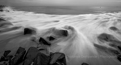 Wave After Wave (Chaitanya Deshpande | Photography) Tags: ocean sea seascape motion canon blackwhite rocks waves seas pondicherry blackandwhitephotography pondy landscapephotography canon1022 rocksonthebeach canonwideangle seamotion pondicherrypier