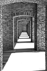 Rhythm (dziurek) Tags: door fiction light shadow urban abstract castle art stone mystery architecture contrast way hope blackwhite back gate europe long arch escape bright artistic time walk gothic masonry corridor entrance tunnel monastery walkway end lonely column walls another cloister concept exit passage salvation jamb lintel interval frighten fugue intricacy jambeau