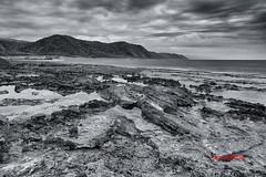 Mudan ( SUNRISE@DAWN photography) Tags: bw cloud mountain beach monochrome coral rock coast gloomy taiwan coastline tidalpool leaden pingtung mudan  wavecutbench  wavecutterrain