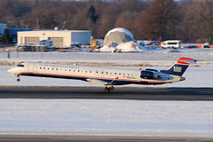 US Airways Express CRJ-900 N934FJ at KCMH (Lunken Spotter) Tags: travel winter columbus sunset ohio snow cold travelling ice plane airplane evening frozen flying airport frost december snowy aviation jets airplanes flight jet freezing sunsets slush landing international airline planes ash oh arrival icy airports aviao wintertime airlines touchdown flugzeug runway airliner avion airliners crj cmh arriving wintry flug internationalairport regionaljet canadairregionaljet crj900 franklincounty mesaairlines usairwaysexpress portcolumbus portcolumbusinternationalairport kcmh centralohio airshuttle regionalairline cl6002d24 crj9 regionalairlines n934fj