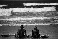 Beach bums (Rob Moseley) Tags: life sea blackandwhite beach cornwall surf north lifestyle lovers romantic surfers fistral
