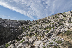 Climbing up a cliff (TheCrazyTravel.com) Tags: espaa cliff girl clouds climb coast seaside spain rocks asturias moutain llanes principadodeasturias