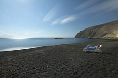 Moonlounger (Alex Bamford) Tags: beach santorini greece moonlight volcanic lounger kamari sleepwalk alexbamford sontorini alexbamfordcom