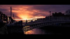 Ha'Penny Bridge - Dublin, Ireland - Color street photography (Giuseppe Milo (www.pixael.com)) Tags: liffey color bridge cinematic street water person city hapenny sun urban sunset streetphotography ireland relflection sky hapennybridge europe dublin figure countydublin ie onsale faceless