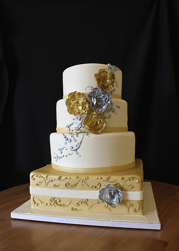 Silver and Gold Regal Wedding Cake with round and square tiers