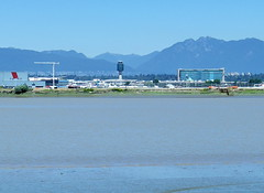 YVR14g08 River Road view of YVR, Richmond BC 2014 (CanadaGood) Tags: blue canada mountains color colour building green vancouver river airport bc britishcolumbia aircraft richmond yvr fraserriver 2014 canadagood thisdecade