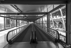Para ir mas rpido / To go more fast (D. Lorente) Tags: madrid bw glass architecture stairs reflections airport nikon metallic perspective symmetry dlorente
