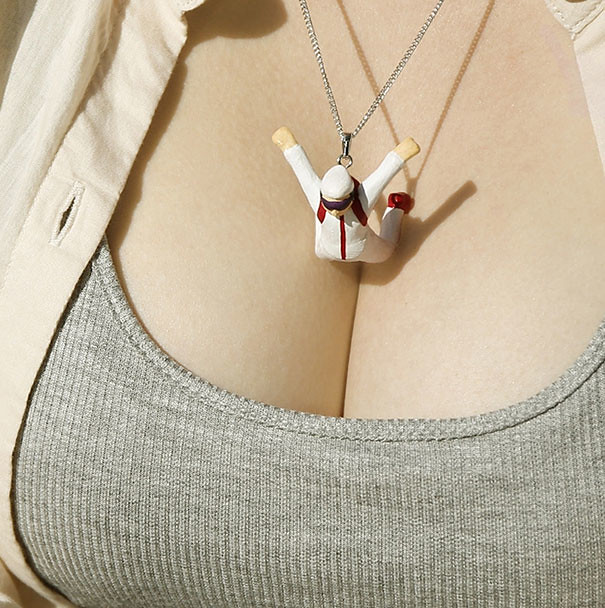 adaymag-tiny-figurines-dive-into-women-s-breasts-in-naughty-necklaces-by-takayuki-fukusawa-08