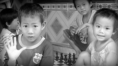 It's never too early, and You are never too young (I m Peace) Tags: morning bw game kids canon children fun happy early play young chess strangers adorable powershot laugh hs sx50