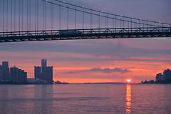 brief appearance (Wade Bryant) Tags: sky clouds sunrise rainy detroitriver ambassadorbridge