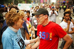 Bill McKibben Greets Mary Evelyn Tucker (Light Brigading) Tags: new york city light youth fossil march energy 21 earth banner overpass september peoples pollution marching planet environment climate indigenous parachute brigade 2014 chane fuels olb occupyriverwest