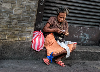 Old woman folding her money