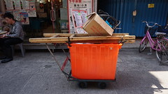 DSC03237 (katherinedriscoll) Tags: transportation movement collection carry trolley box orange adaption rope red string cheungchau hongkong island market shop front vendor
