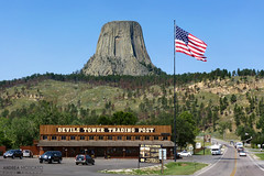 Devils Tower - Wyoming (Andrea Moscato) Tags: road park street wood blue trees sky parco usa mountain tree green monument nature car yellow rock pine alberi america landscape us office strada unitedstates post natural stones flag indian entrance natura national cielo np roccia pietra montagna paesaggio bandiera statiuniti naturale andreamoscato
