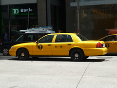 Ford Crown Victoria (NYC Taxi) (JLaw45) Tags: road street door new york city urban ford yellow america sedan four state metro cab taxi united transport victoria clean company transit crown metropolis motor states fleet avenue sixth 6th steelies