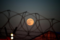Barb wire moon (nic_r) Tags: moon fence wire nikon luna full fullmoon 300mm barbedwire barb barbwire barbed lunar d5100